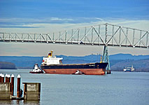 A photo of a transoceanic ship passing under the Longview bridge.